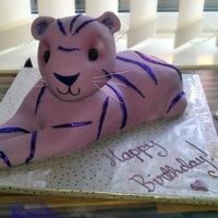 Purple Tiger   Please excuse the mess! 3d purple tiger with glitter stripes for my best friend's birthday. Pound cake body, rkt head.