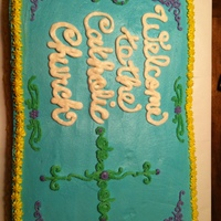 Cross Cake This cake was made for a welcoming reception at a Catholic church. It is a whole sheet cake iced in all BC.