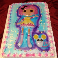 "Lalaloopsy a full sheet cake with whipped icing and airbrushed. the doll and mouse are a layon topper which is 17"" long."