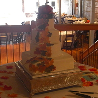 Leaves Are Falling 4 tier multi shaped wedding cake with fondant leaves airbrushed, covered in mmf, and had cake topper special made
