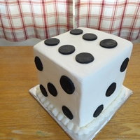 Dice Cake  4 layers of chocolate Cake with Raspberry filling, buttercream filling, and cookies & cream filling. Cake covered with modeling...