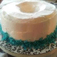 Blue Velvet Coconut Creme Cake With Cream Colors for the church anniversary were teal, so I made a red velvet and substituted teal gel for the red food color. I also added coconut...