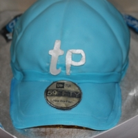Baseball Cap My 1st attempt at a ball cap. They wanted me to try to do one with just buttercream (costs) but the fondant was a must! i have some flaws...