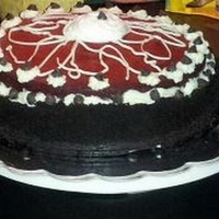 Red Velvet Cheesecake Red Velvet cheese cake. with a layer of chocolate ganache, cheesecake and red velvet cake.