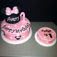 Minnie Mouse 2 tier minnie mouse. gum paste ears and #1, hat is cake :)
