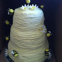 Beehive Baby Shower Cake 3 tier carved cake, all buttercream outside. Gum paste bees and daisies. I forgot the flowers, had to go to the customer the next morning...