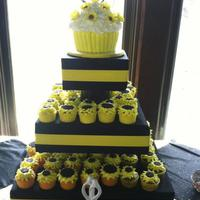 Sunflower Cupcakes And Large Cupcake Cake 3 flavor cupcakes all have a combo of small and regular sized oreo's for the centers. gumpaste sunflowers adorn the big cupcake cake...