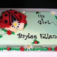 Ladybug Baby Shower, Baby Butt Cake gumpaste daisies and ladybugs, fondant dress covering the bum :)