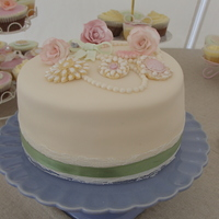Vintage Wedding Cake And Cupcakes Main cake, finished off with lace and ribbon.