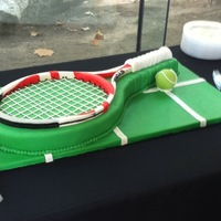 Tennis Cake Tennis cake: Tennis Raquet made from home made fondant, chocolate tennis ball. Lemon cake with beveria cream filling. This was a grooms...