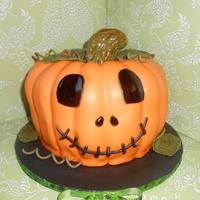 Jack-O-Lantern Cake Cake center is filled with candy corn. Stem is made from rkt and covered in fondant. Fun cake to make! TFL!