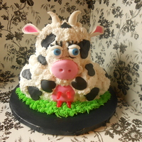 Cow Birthday Cake Cow birthday cake iced in buttercream with gumpaste and fondant accents. Eyes are gumballs and udders are Mike & Ike candies. The cow...