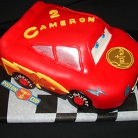 Lightning Mcqueen Pink lemonade cake with vanilla buttercream fondant. The tires are rice krispy treats