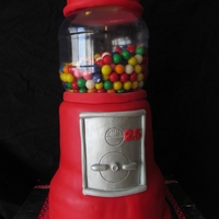 Gumball Machine Cake Layers of almond cream cake covered with vanilla buttercream fondant.