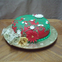 "Holiday Hat Cake I covered the 9"" contoured cake with a butter cream crumb coat. Then I covered it with red fondant & I did all the details with..."