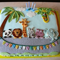 Safari Cake Fondant covered cake with painted fondant cut out figures.Inspiration from freubelmuisje http://cakecentral.com/gallery/2246090/going-to-...
