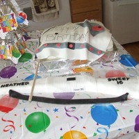 16Th Birthday Winterguard Theme Flag Cake & Rifle 9x13 Cake with Fondant Flag draped over buttercream frosting. RKT Rifle, covered with fondant. All edible except foil used to make rifle...