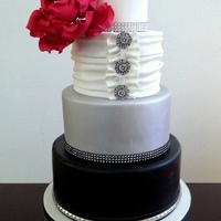 Fondant Wedding Cake Bottom Tier Is Airbrushed Black With A Faux Leather And Studded Band Third Tier Is Airbrushed Silver Second Tier Fondant wedding cake. Bottom tier is airbrushed black with a faux leather and studded band. Third tier is airbrushed silver. Second tier is...