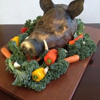 Boar's Head Cake Boars Head Cake made from modeling chocolate with fondant accents. Fresh vegetables.