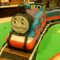 Thomas The Tank Engine Thomas the tank engine cake, first time making a train cake...had a little difficulty carving it, but it wasn't too hard!