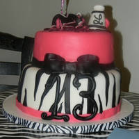 Zebra/cheerleader Cake This cake was for my cousins step-daughter who is a cheerleader and loves zebra stripes....First time doing zebra stripes on a cake, earier...