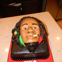 Bob Marley/rasta Man Cake I was trying to make BoB Marley but since this was my first time scuplting a face I was glad that it at least came out looking like a...