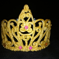 Royal Icing Tiara Royal Icing airbrushed with gold. Jewels not edible.