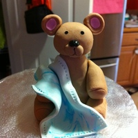 Teddy Bear Baby Shower Cake Teddy bear is gumpaste. Cake is WASC covered in ganache and MMF.