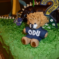 Odu Monarch For husband's 50th birthday, first attempts at fondant/gumpaste figures. ODU Monarch mascot figure.