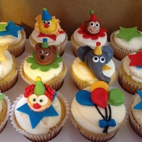Circus Cupcakes A dozen circus cupcakes for a Birthday Wishes party. I'd hoped to do character toppers for all of them but since this was my 1st time...