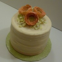 "Kim's 1St Anniversary A 6"" white cake filled with key lime curd and iced with key lime buttercream. Topped with gumpaste flowers."
