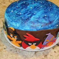Angry Birds Space   Chocolate cake covered with moka buttercream! All decorations are made out of fondant.. Thanks for looking