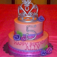 Princess Cake Princess birthday cake, with ribbon roses topped with a crown for the birthday princess.
