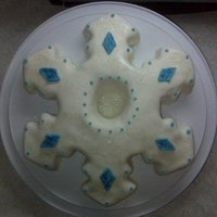 Snowflake  Snowflake shaped cake. Could not find an example anywhere - so I created a template and carved away! Iced in buttercream, covered in MMF,...