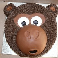 "Monkey Cake   Cake made for a baby shower with a ""monkeying around"" theme. Vanilla cake covered in chocolate buttercream and chocolate MMF."