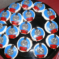 Thomas The Tank Engine Cupcakes  Marble cupcakes in Thmas liners topped with handmade fondant Thomas the Tank Engines. Made for a baby shower - baby's name was Thomas...