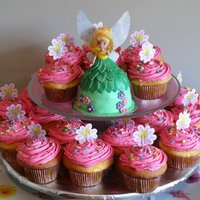 "Tinkerbell Smash Cake With Cupcakes  Tinkerbell cake made from a mini wondermold and small Tink doll. Iced in buttercream and covered in MMF. ""Matching"" cupcakes with..."