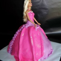 Barbie Birthday Cake Barbie cake, got the instructions here on cake central. I had a seam showing down the back...so I covered it in roses and I think it's...