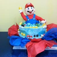 Super Mario For A Super Birthday Boy! My Grandson wanted a Super Mario cake for his birthday, and since I had just started experimenting with Fondant, I went looking. This cake...