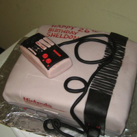Nintendo Cake Chocolate cake, with cookies and cream filling. Fondant controller