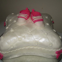 Baby Shoes On Pillow Used my new Wilton Pilow pan set!! Made the shoes out of fondant, and gumpaste