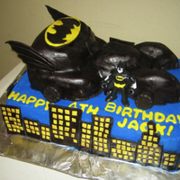 Batman/batmobile Cake Carved batmobile out of cake, with fondant details. Batman is a toy
