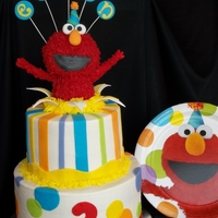 Ethan's Elmo Cake This is a two tiered buttercream cake with fondant decorations. Elmo is made from crispy treats and covered in red fondant and then a...