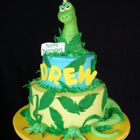 Drew-A-Saurus This is a 2 tier, 3 layer buttercream cake w/ fondant and gumpaste decorations. The cake is confetti white almond sour cream w/ vanilla-...