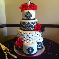Damask Wedding Cake Damask wedding cake. Satellite cake bottom tier, fondant billow effect 3rd tier. Damask pattern stenciled with royal icing. Flowers and...
