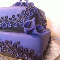 "Purple Swirl Cake Fondant covered cake, calla lillys, and ""A"". Handpiped swirls. The cake was purple, my camera sometimes changes the color to blue..."