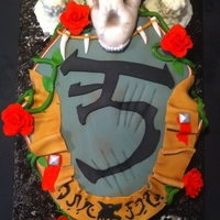 World Of Warcraft- Worgen Crest I made this cake for my uncles birthday, he is a huge World of Warcraft fan. His character is a Worgen so I made the Worgen Crest. Spice...