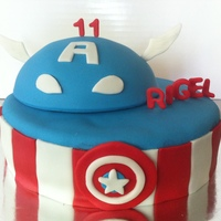 Captain America Cake This cake was inspired by a few different cakes here on CC. I did the cake to look kind of like Captain America's costume and the top...