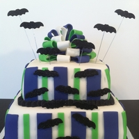 Halloween Bat Cake Fondant bats coated in edible glitter, fondant bows and decorations.