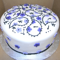 Purple & Black Paisley Everything in black is royal icing, everything else is mmf.